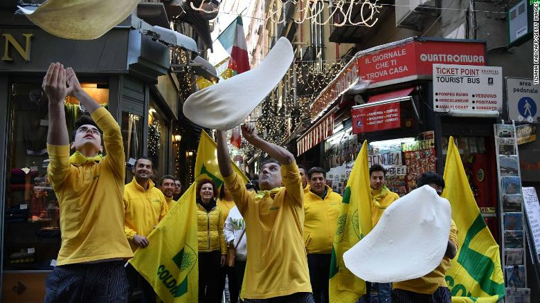 "Members of the Pizzaioli Acrobats Coldiretti perform ""twirling"" pizza to celebrate the Unesco decision to make the art of Neapolitan ""Pizzaiuolo"" and pizza as a world heritage."